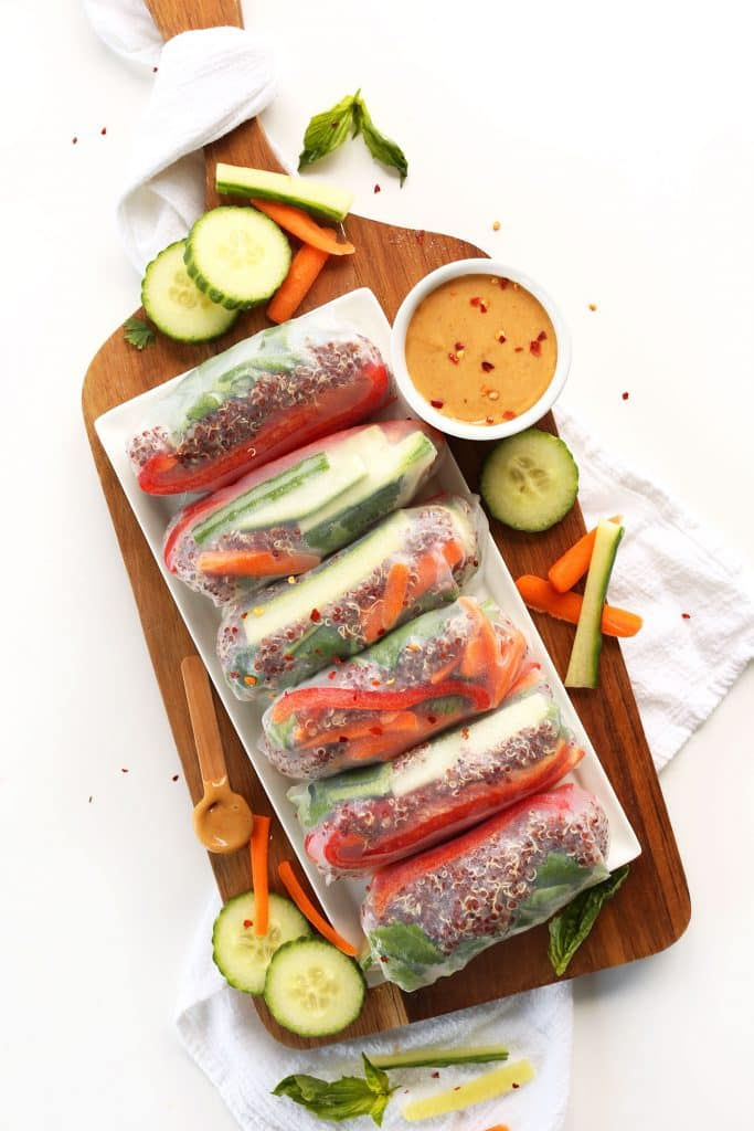 quinoa spring rolls on a wood tray