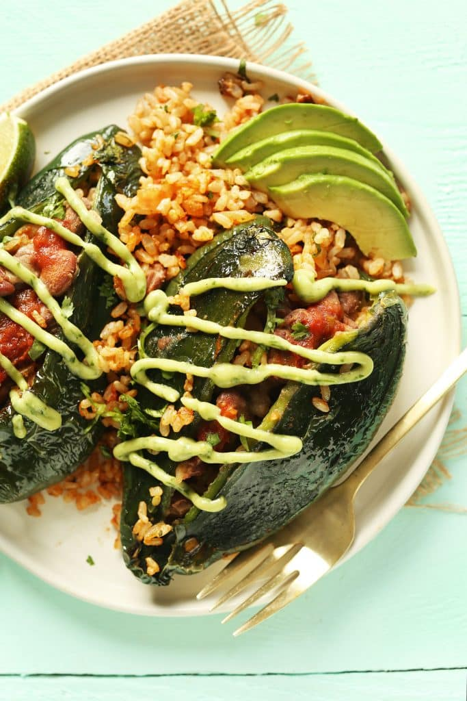 plate of stuffed peppers and avocado